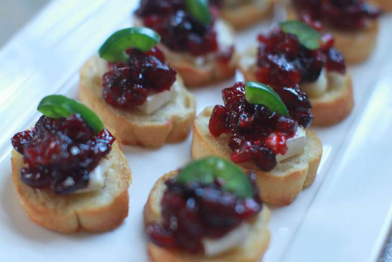 Spicy cranberry and pomegranate, brie crostini bites