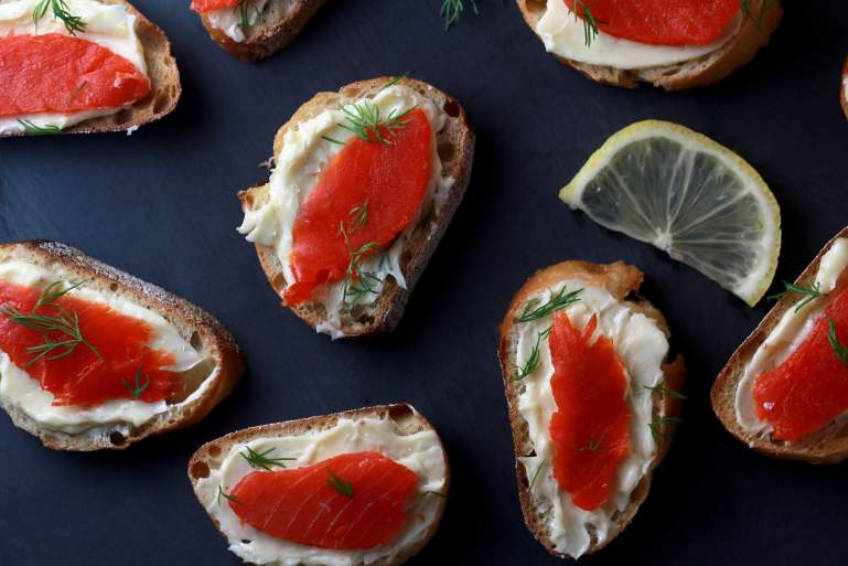 Smoked salmon crostini bites with mustard butter and dill