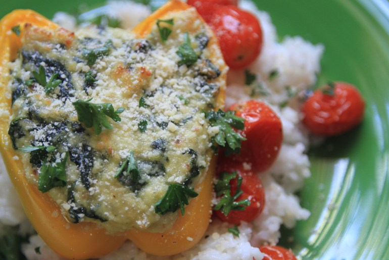 Vegetarian stuffed peppers made with spinach and ricotta.