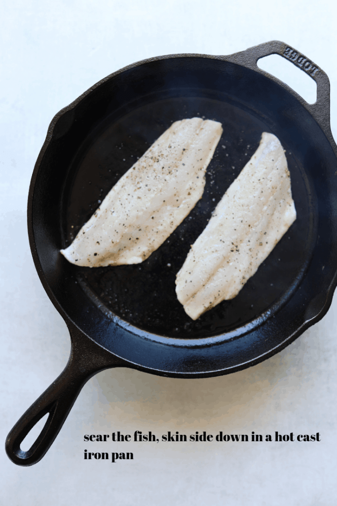 crispy skin branzino cooking in a pan