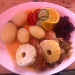 Pork with pineapple, sauerkraut, mushrooms, beets, slaw, and veggies