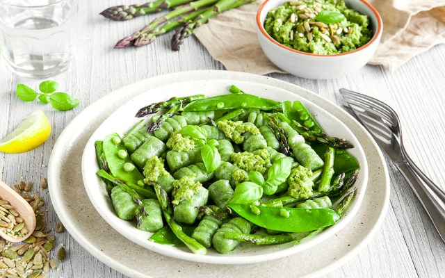 Homemade Spinach Gnocchi with Pea Pesto and Green Vegetables. Vegetarian Recipe.