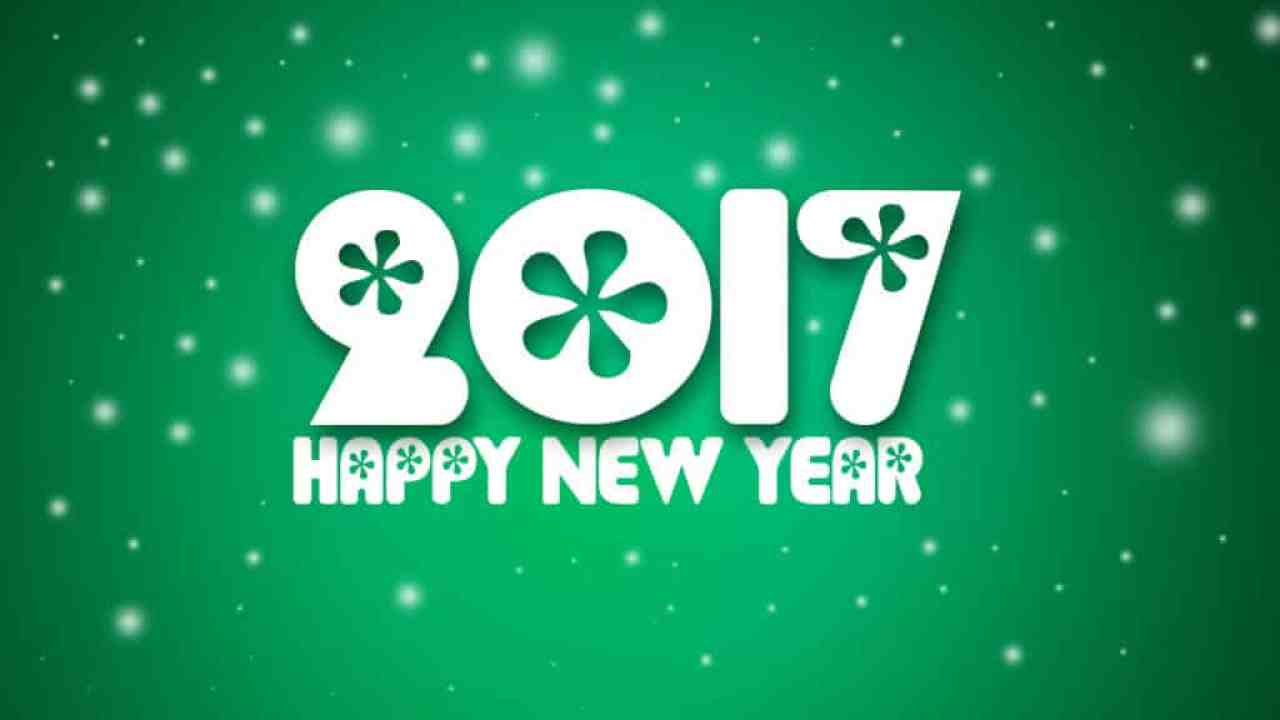 Happy New Year 2017 with snowflakes on green background