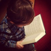 Jon reading hymnal