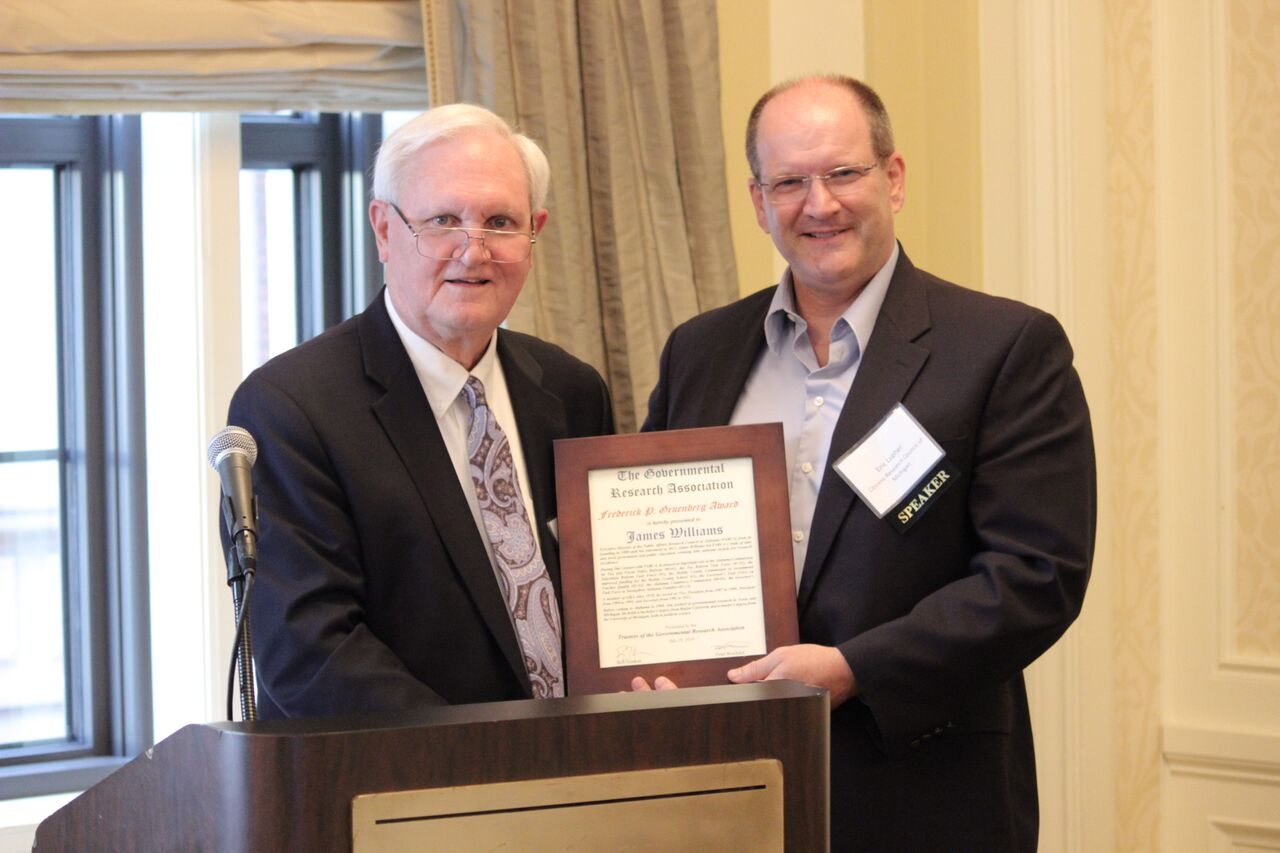 Citizens Research Council President Eric Lupher presents the Gruenberg Award to former Research Director Jim Williams at the 2016 Governmental Research Association Conference