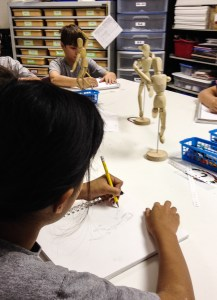 Students sketching mannequin - Sketchbook Assignment