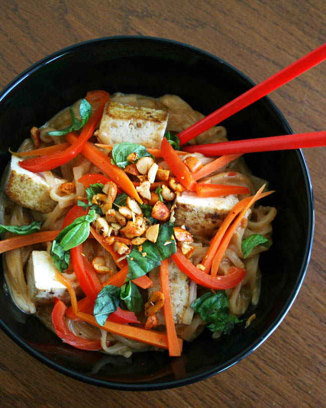 Tofu and Thai Noodles with Peanut Sauce (vegan, gluten free) - This rich dish is a comfort food favorite! Thai noodles are covered in sweet and spicy peanut sauce.