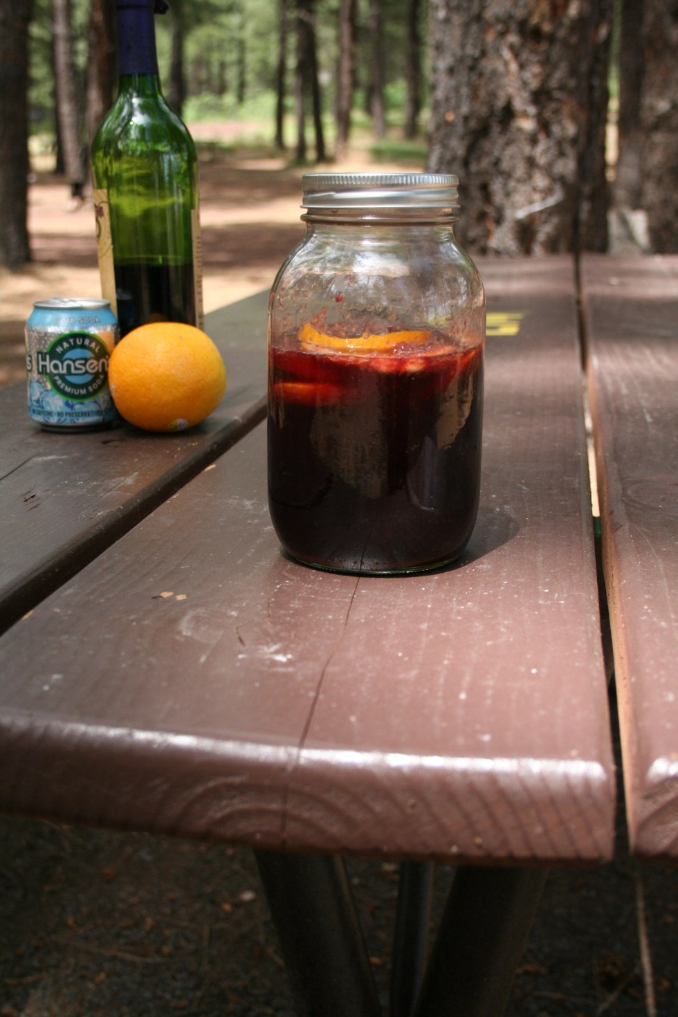 Camping Sangria - Sangria is an easy cocktail to make while camping. It is sweet and refreshing with club soda, orange juice and red wine.