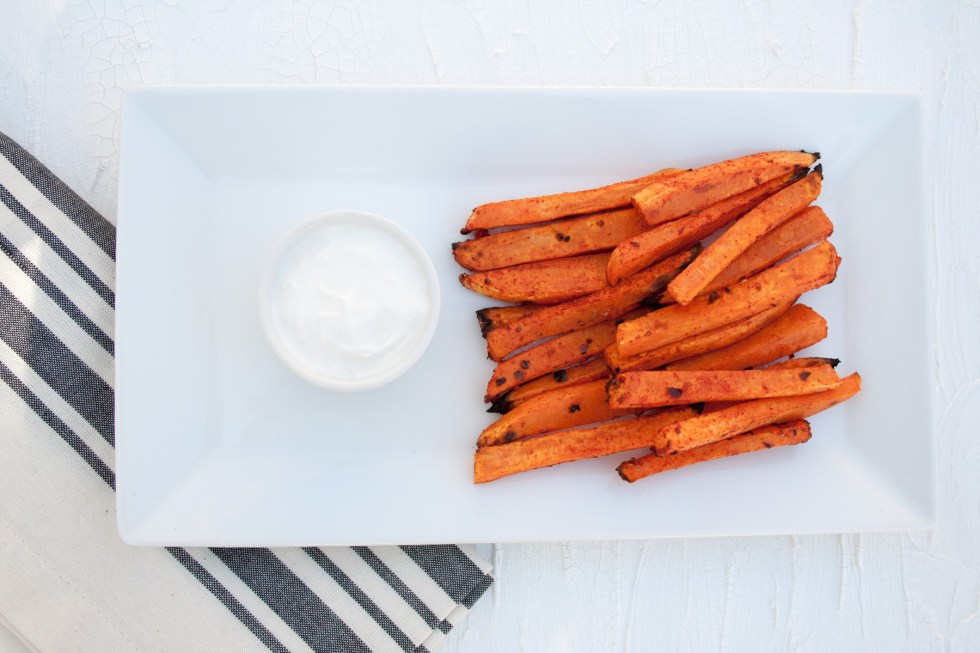 Spicy Sweet Potato Fries - These fries will satisfy your spicy food craving! Sriracha powder gives these sweet potato fries a kick.