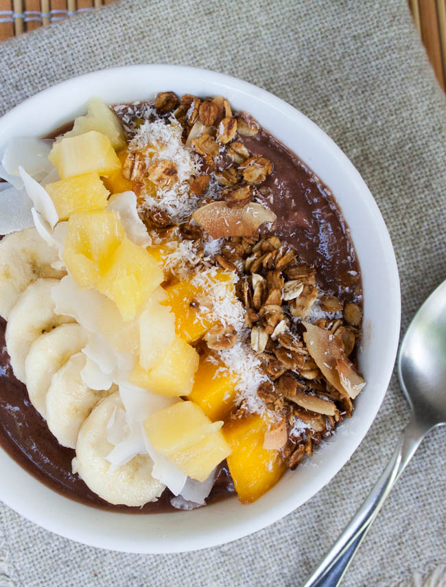 Tropical Acai Bowl (vegan, gluten free) - This sweet recipe is a tropical island in a bowl. You will feel like you are eating dessert, but it is healthy!