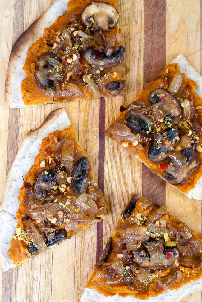 Chipotle Pumpkin Pizza with Caramelized Onions and Mushrooms birds eye vertical.