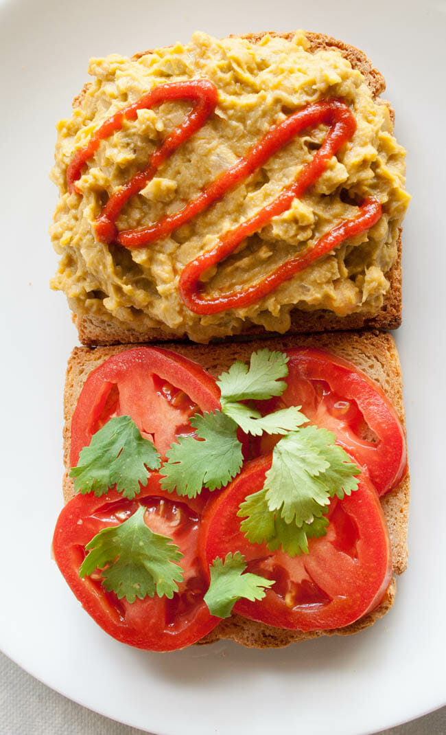Smashed Chickpea and Avocado Sriracha Salad Sandwich open faced.