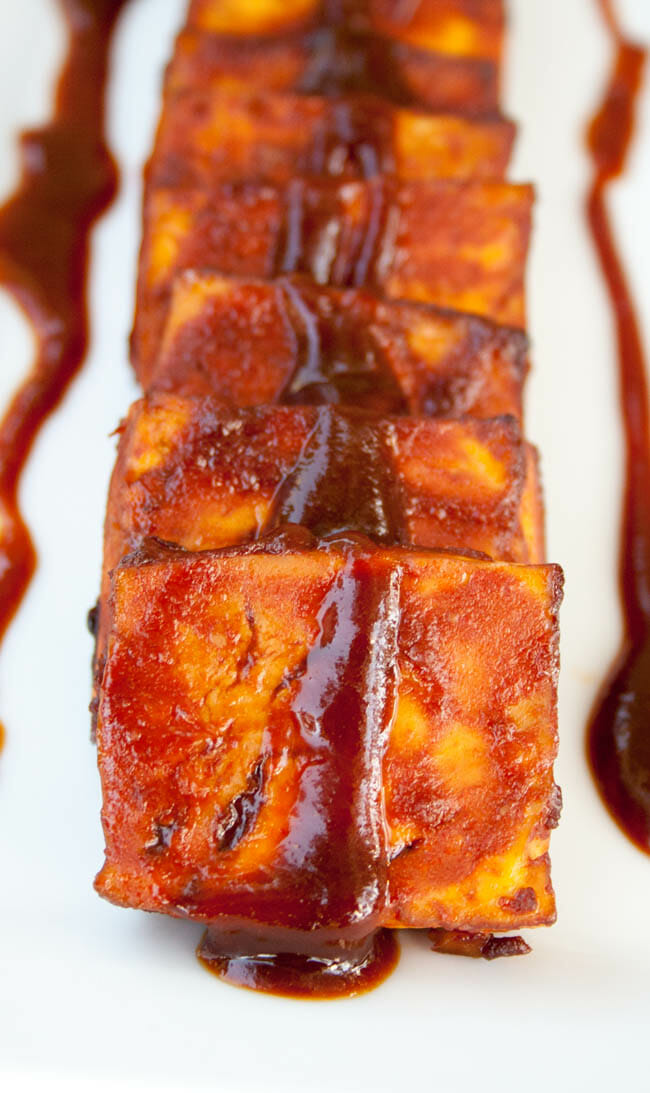 Baked BBQ Tofu with sauce drizzled on top.