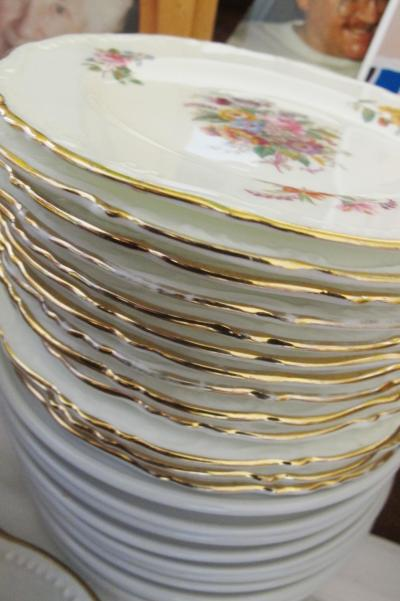 Stack of gilded vintage plates