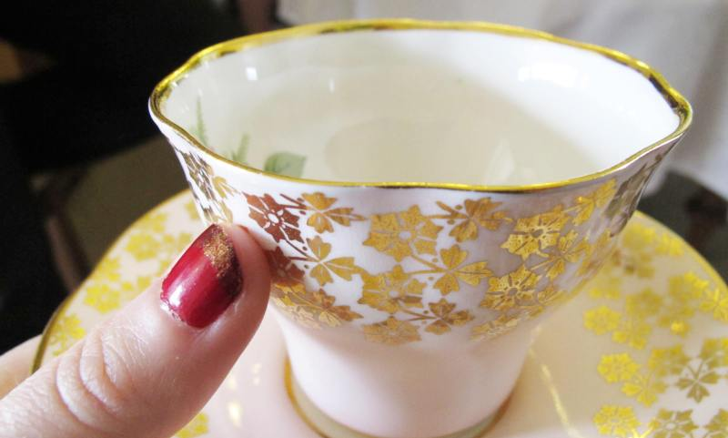 Vintage teacup with gold pattern