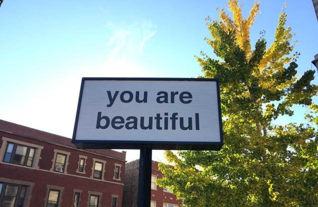 """Sign that has text """"You Are Beautiful"""" against blue sky"""