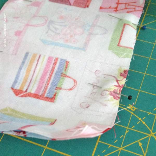 Pin the right sides of the fabric together