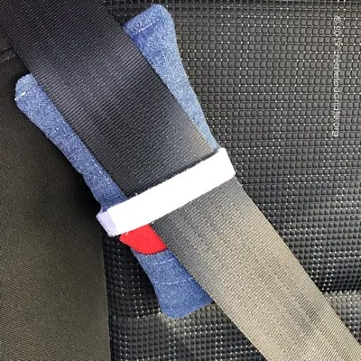 Aromatherapy port pillow attached to a car seatbelt.