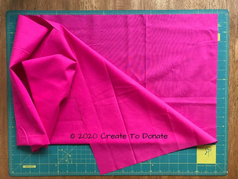 Fold double mastectomy pillow fabric in half lengthwise