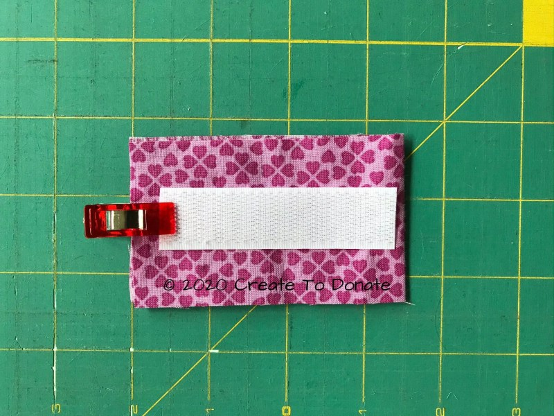 Place tape onto fabric for sewing port pillow