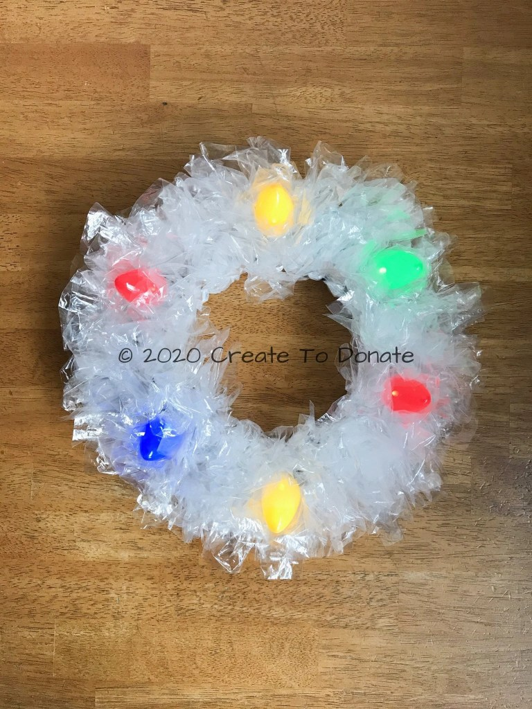 Dollar tree holiday wreath with lights finished