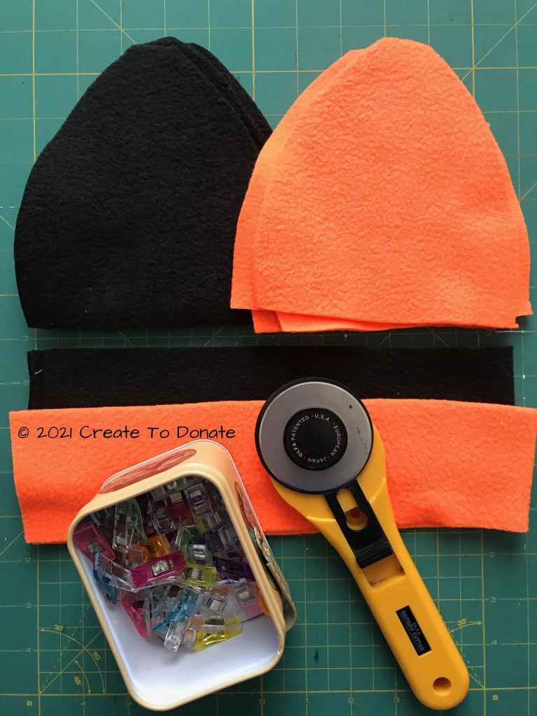 Reversible fleece hat pattern pieces cut out to showcase what's needed for project.