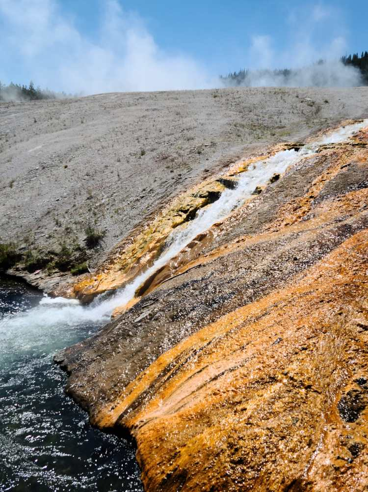 Gushing runoff from the Excelsior Geyser Crater at Yellowstone National Park