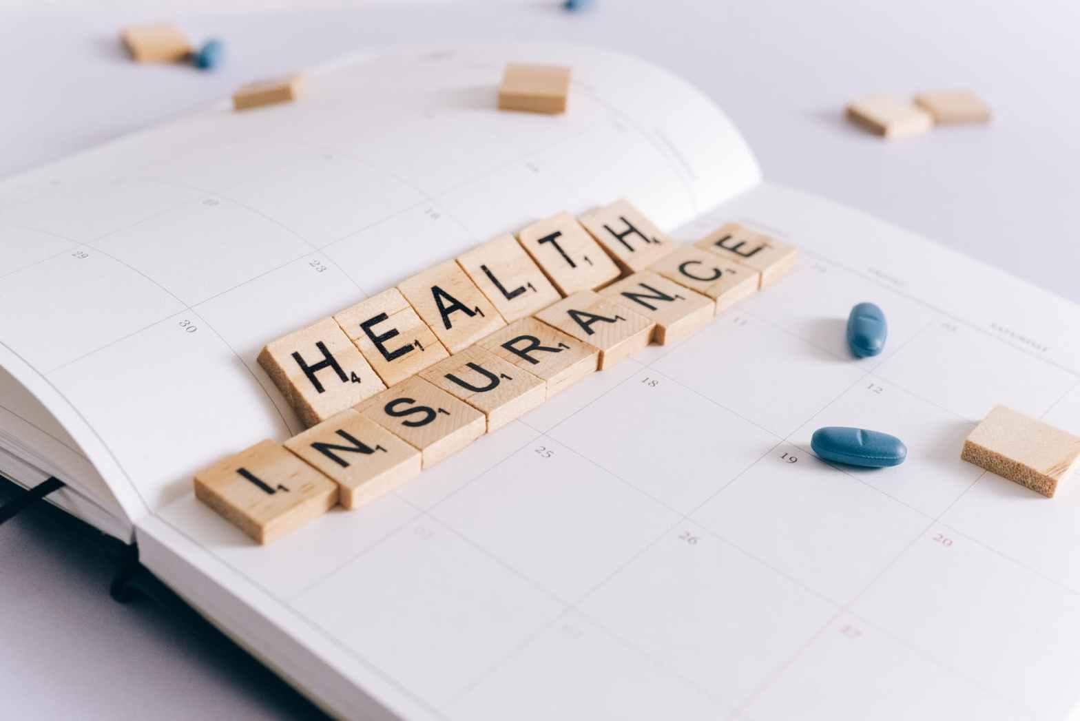health insurance scrabble tiles on planner