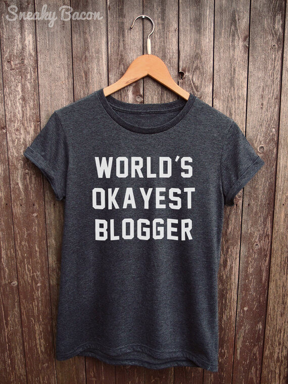 "Know a blogger with a great sense of humor? (Or maybe that's you?!) Grab this ""world's okayist blogger"" tee! See more in this Fun Gift Guide for Entrepreneurs at www.CreatingBeautifully.com!"