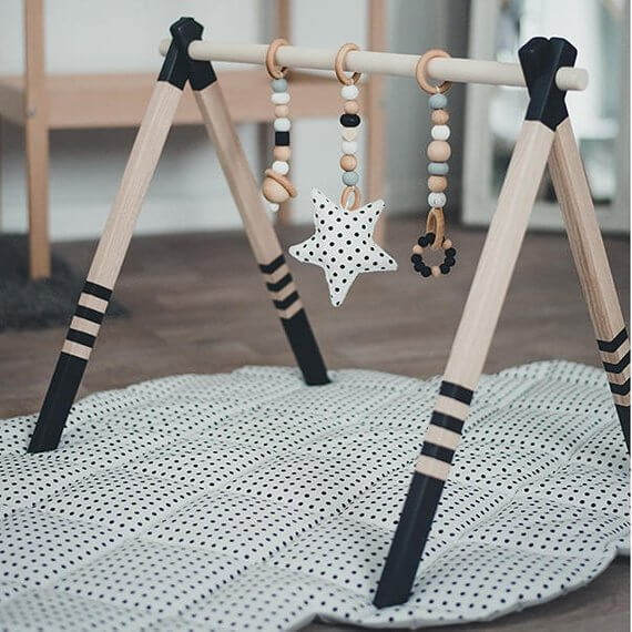 Shop Small This Holiday Season: Gift this High Quality Wooden baby play gym by CotandCot on Etsy for under $100! #giftguide #shopsmall #shophandmade