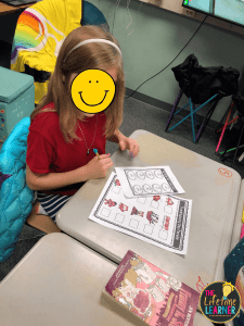 kid working during a thanksgiving classroom transformation