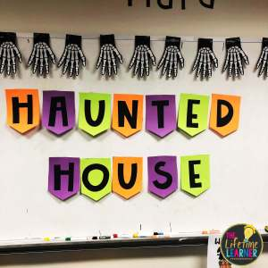 classroom decorated for Halloween with a banner that says Haunted House