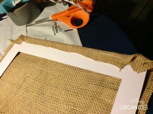 Hot glue is the easiest way of securing the burlap to the matting
