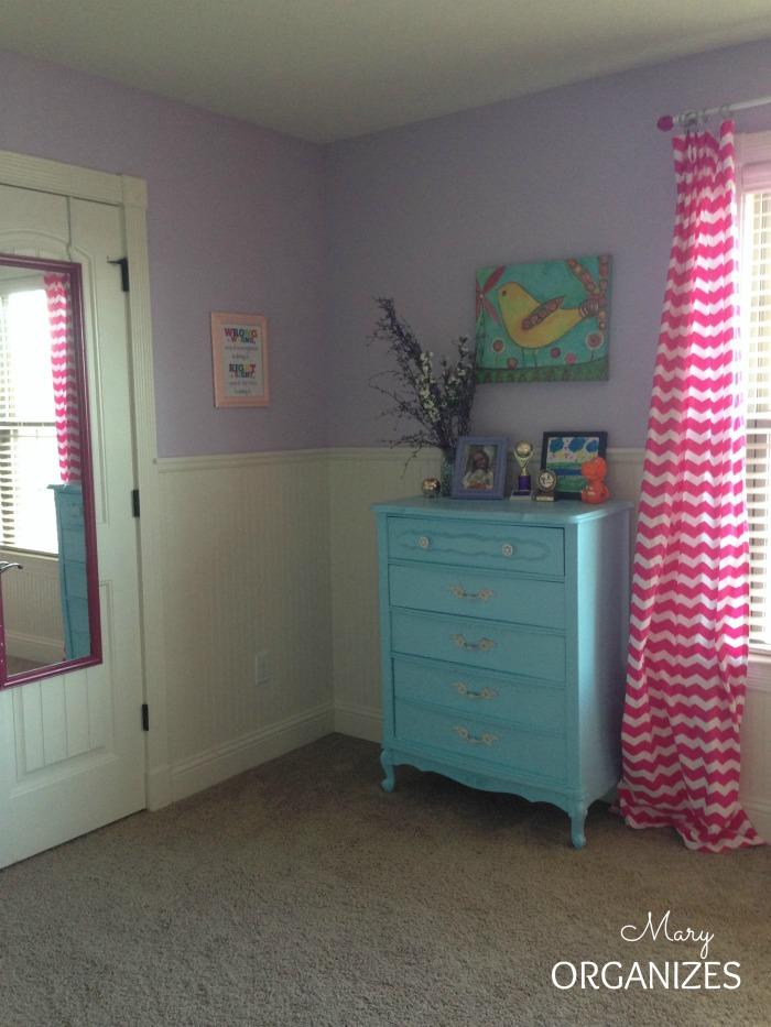 Blue dresser and pink chevron curtain