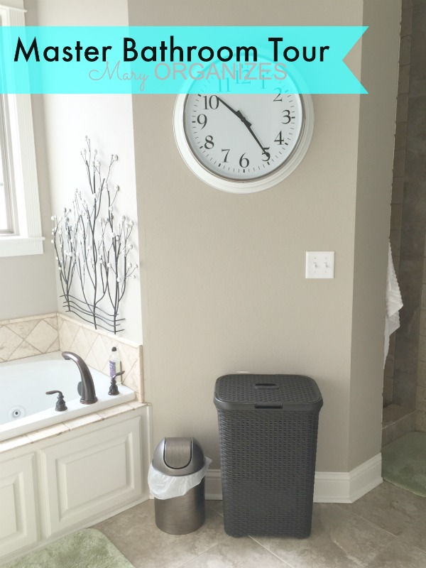 Mary ORGANIZES Master Bathroom Tour - clock hamper and garbage