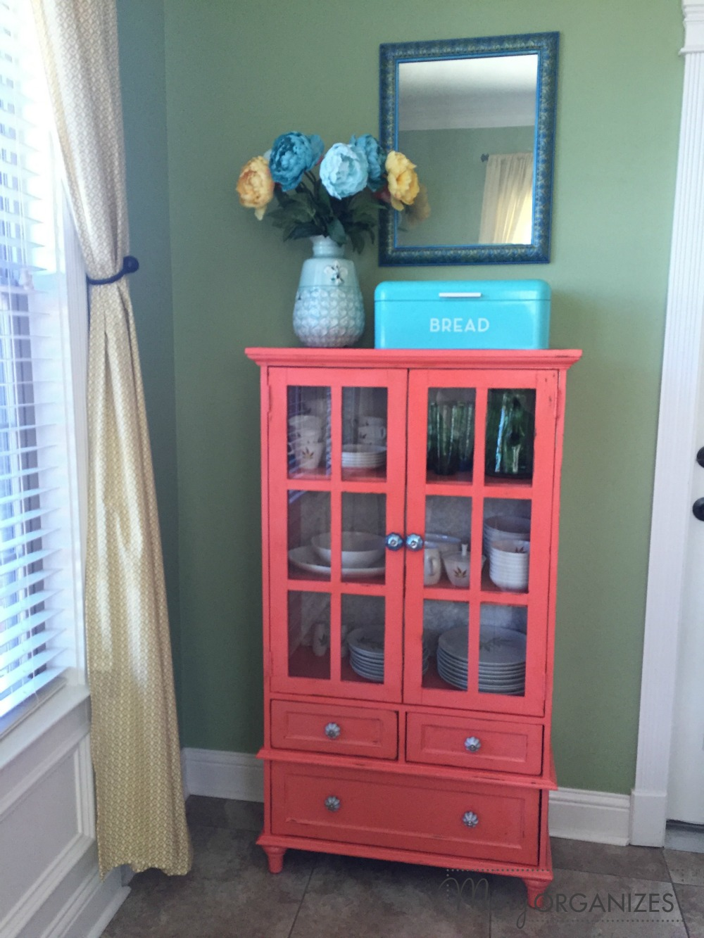 Mary Organizes - coral cabinet
