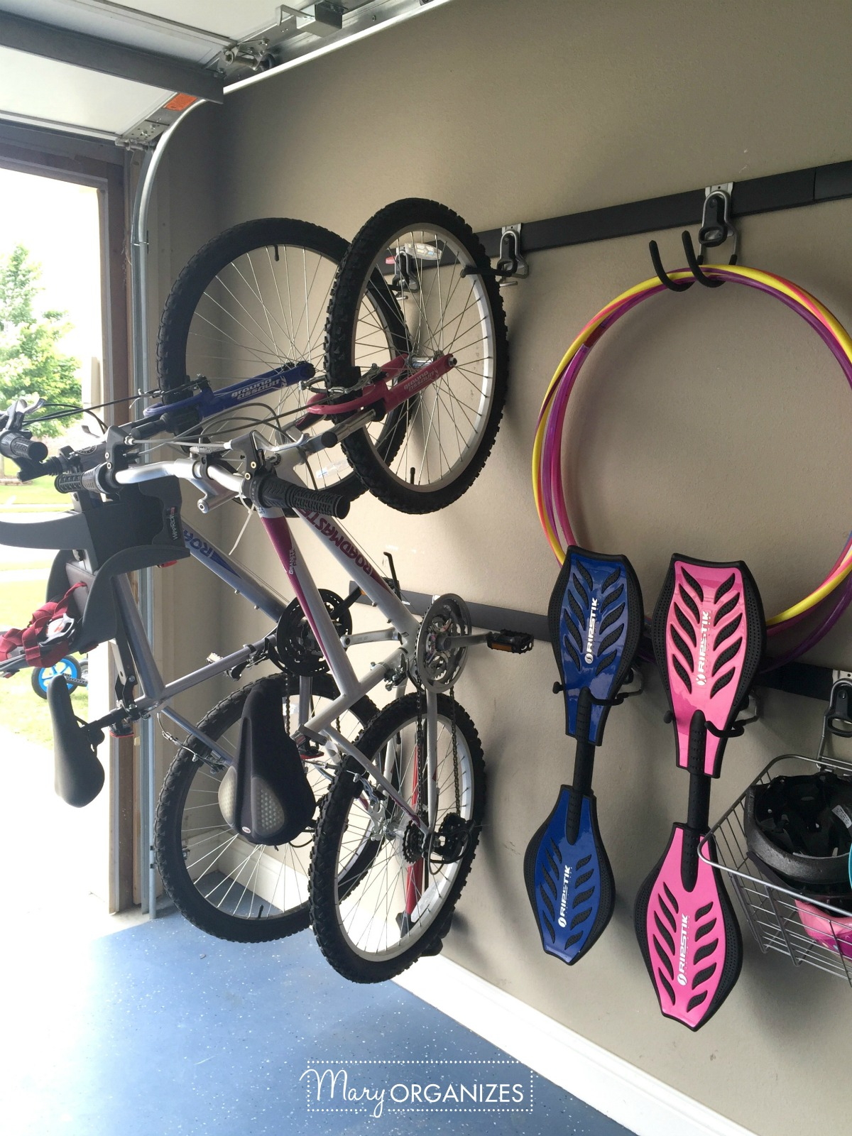 Garage Organizing - How to hang bikes scooters ripsticks balls and more -g1
