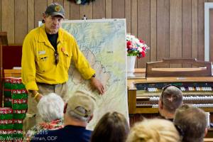 A Fire Crew leader explains  to  Azalea, Oregon  residents the newest fire map and the companies deployed to fight the Stouts fire.
