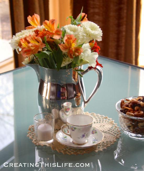 vintage-bridal-shower-flower-arrangement-silver-pitcher