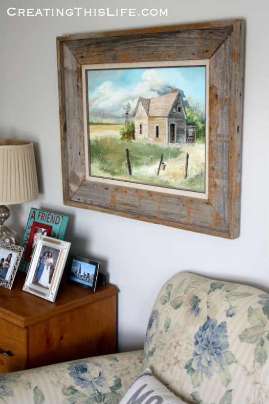 framed oil painting in home office