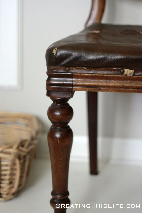 Antique wood and leather chair closeup