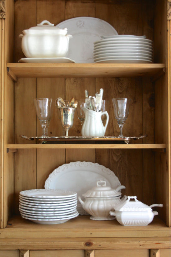 Dining room hutch with white ironstone and silver