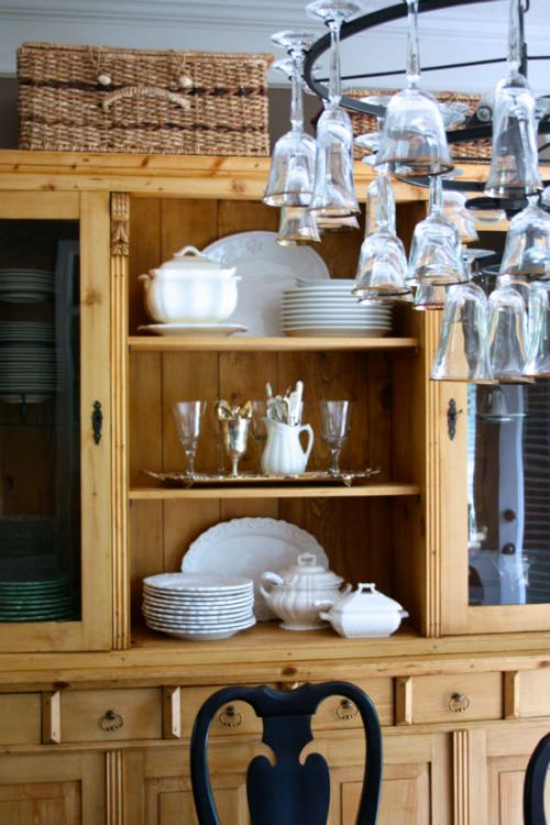 Traditional dining room with pine white dishes silver and clear glassware