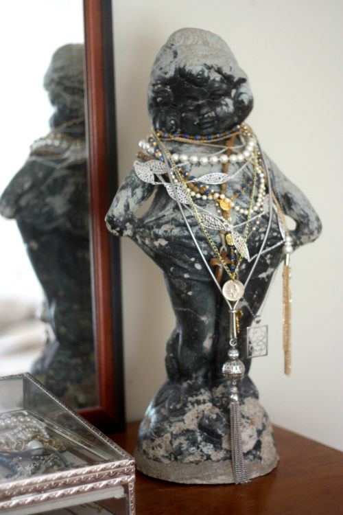 Outdoor statue holding jewelry