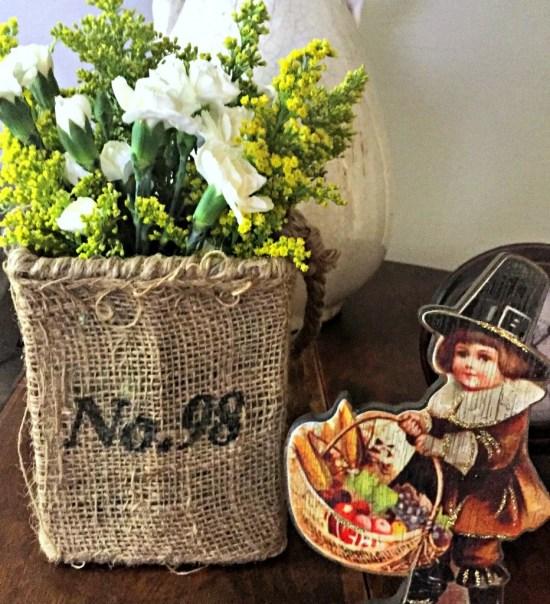 Thanksgiving flower arrangement in burlap vase