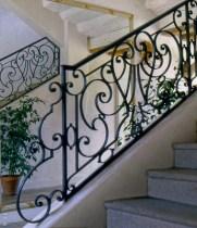 Rampe d'escalier ferronnerie d'art
