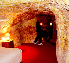 Residents at the opal-mining town of  Coober Pedy, Australia, live in caves like this, complete with kitchen,  comfortable furniture and modern lighting.