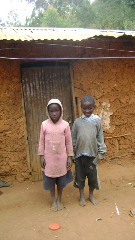 Charles and Boniface outside their grandmother's house