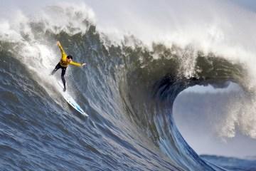 Maverick Surf Competition wave and man, photo credit: Shalom Jacobovitz