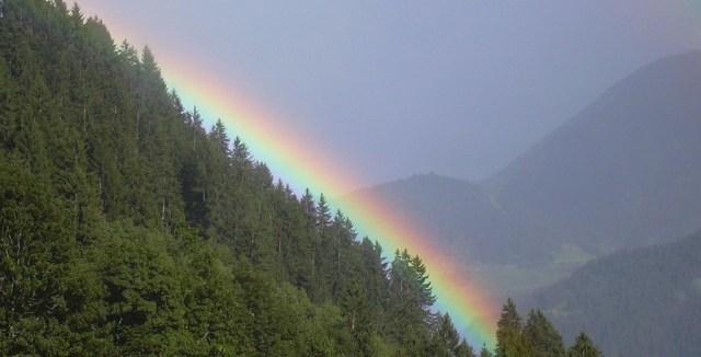 Rainbow alongside a Wooded Mountain- WikiCommons